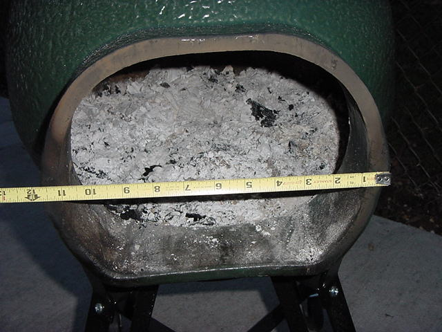 Amazing Spark Arrestor Removed, And A Tape Measure Showing The Size Of The Opening.  You Obviously Don`t Use Fireplace Sized Logs, Something A Little